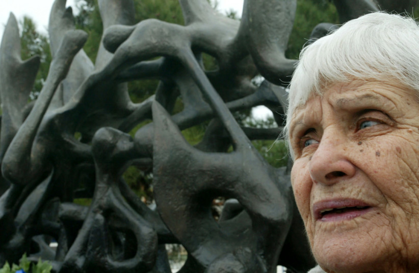 Holocaust survivor Greek Jew Gianna Dartzoglou-Sabikario stands next to a holocaust monument in Thessaloniki January 27, 2005, marking the 60 years from the liberation from the Nazi's death camp at Auschwitz. An estimate of 50,000 Greek Jews were killed at death camps during World War II. (photo credit: REUTERS)