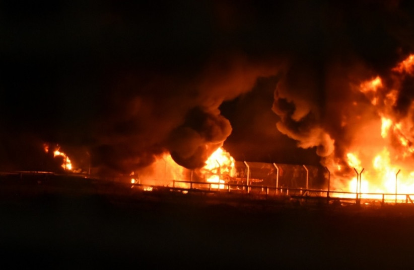 Kerem Shalom crossing burning on the Palestinian side after Friday protests  (photo credit: IDF SPOKESMAN'S UNIT)