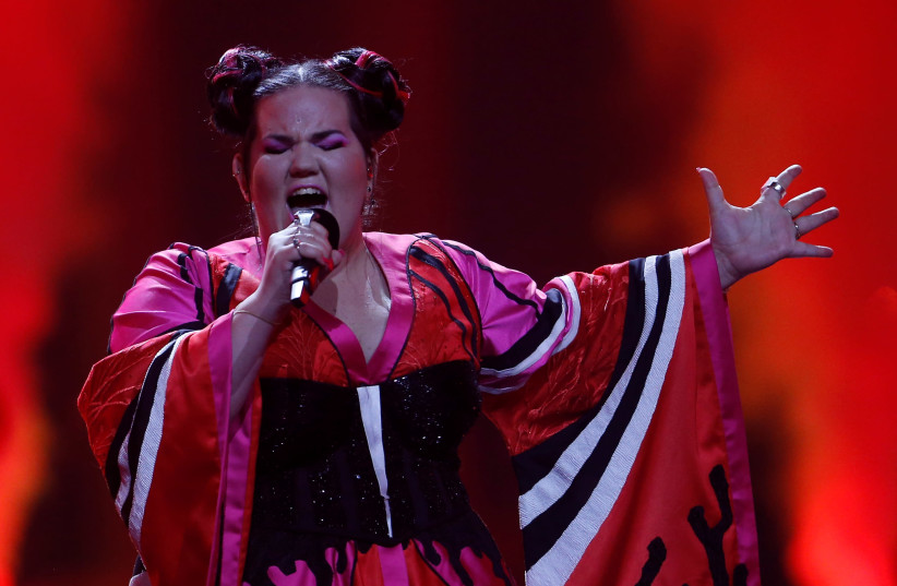 """Israel's Netta performs """"Toy"""" during the Grand Final of Eurovision Song Contest 2018 at the Altice Arena hall in Lisbon, Portugal, May 12, 2018 (photo credit: REUTERS/PEDRO NUNES)"""