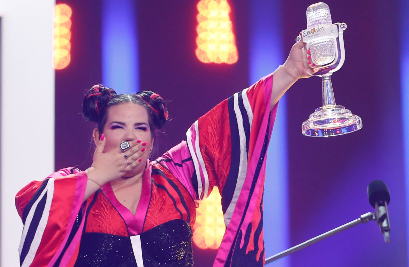 Israel's Netta reacts as she wins the Grand Final of Eurovision Song Contest 2018 at the Altice Arena hall in Lisbon, Portugal, May 12, 2018 (photo credit: REUTERS/PEDRO NUNES)