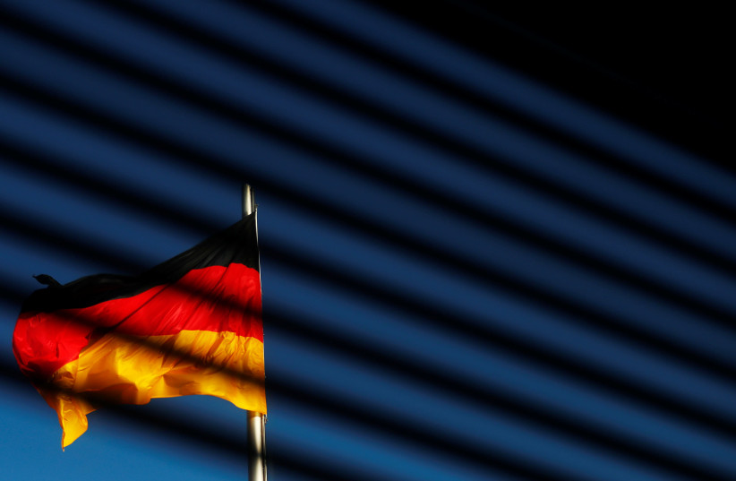 The German flag is pictured at the Reichstag building in Berlin, Germany, November 7, 2017 (photo credit: REUTERS/HANNIBAL HANSCHKE)