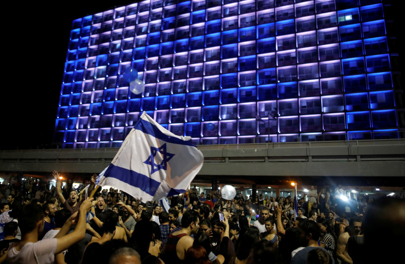 "People celebrate the winning of the Eurovision Song Contest 2018 by Israel's Netta Barzilai with her song ""Toy"" , Rabin square in Tel Aviv, Israel, May 13, 2018. (photo credit: REUTERS/CORINNA KERN)"