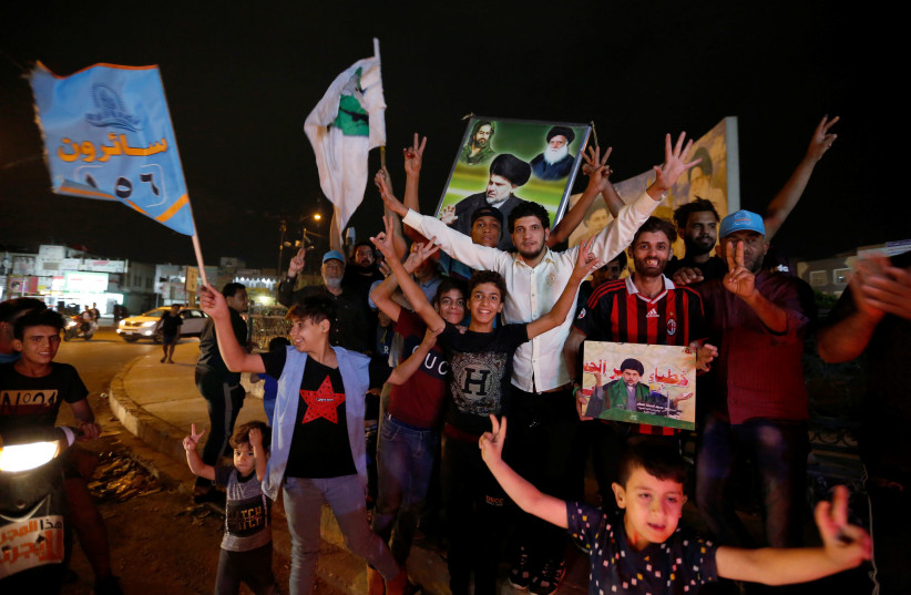Iraqi supporters of Sairun list celebrate after the closing of ballot boxes during the parliamentary election in Sadr city district of Baghdad, Iraq May 12, 2018 (photo credit: AKO RASHEED / REUTERS)