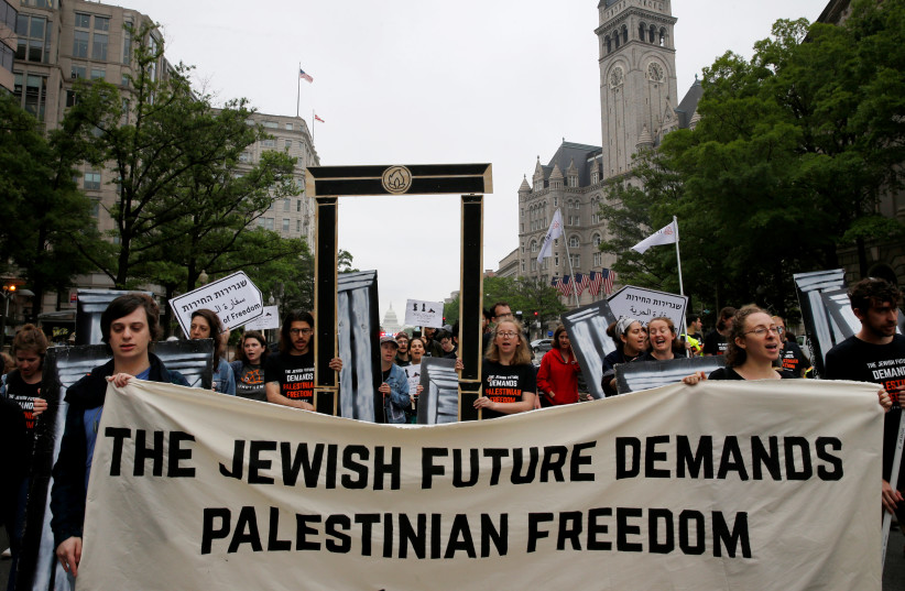 People organized by IfNotNow protest outside of Trump International Hotel against the new U.S. Embassy opening in Jerusalem in Washington, US, May 14, 2018 (photo credit: REUTERS/LEAH MILLIS)