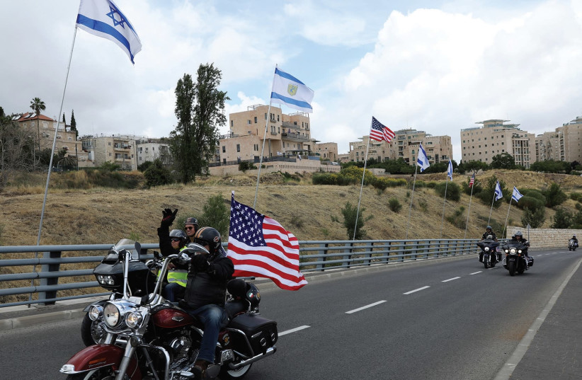 A biker rides near the new site of the US Embassy in Jerusalem (photo credit: REUTERS)