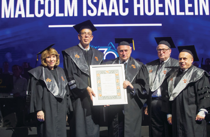 Malcolm Hoenlein (center) receives his honorary doctorate from Bar-Ilan University  flanked by (from left) Gail Propp, Prof. Arie Zaban, president of BIU, Michael Jesselson s and Jewish Agency Chairman Natan Sharansky (photo credit: CHEN DAMARI)