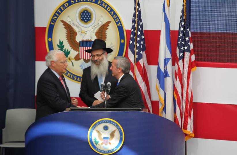 Pastor Robert Jeffress and Rabbi Rabbi Zalman Wolowik share the stage with U.S. Ambassador David Friedman at the openening ceremony for the U.S. embassy in Jerusalem (photo credit: HILLEL MEIR/TPS)