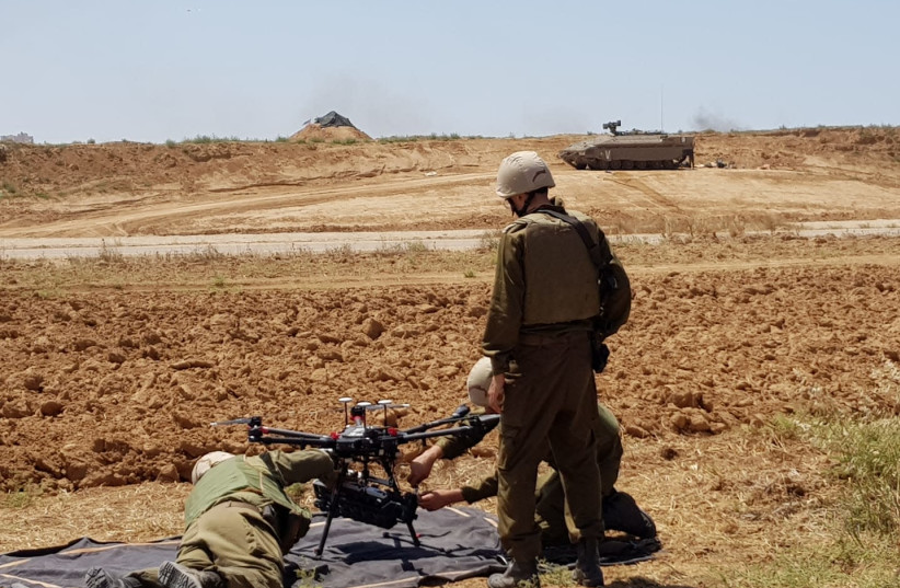 IDF soldiers prepare a drone for usage near the Gaza border, May 15th, 2018. (photo credit: ANNA AHRONHEIM)