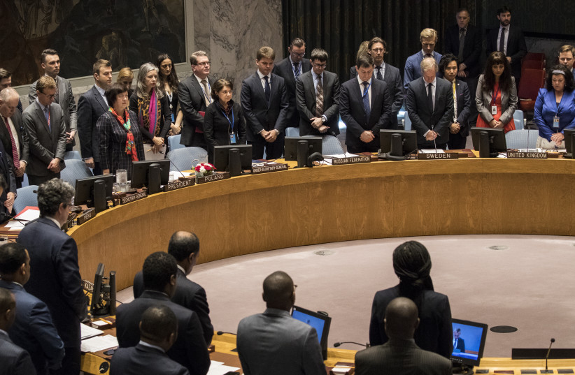 Members of the United Nations Security Council observe a moment of silence for those killed in the Gaza Strip on Monday, before the start of a UN Security Council meeting concerning the violence at the border of Israel and the Gaza Strip, at United Nations headquarters, May 15 (photo credit: DREW ANGERER / AFP)