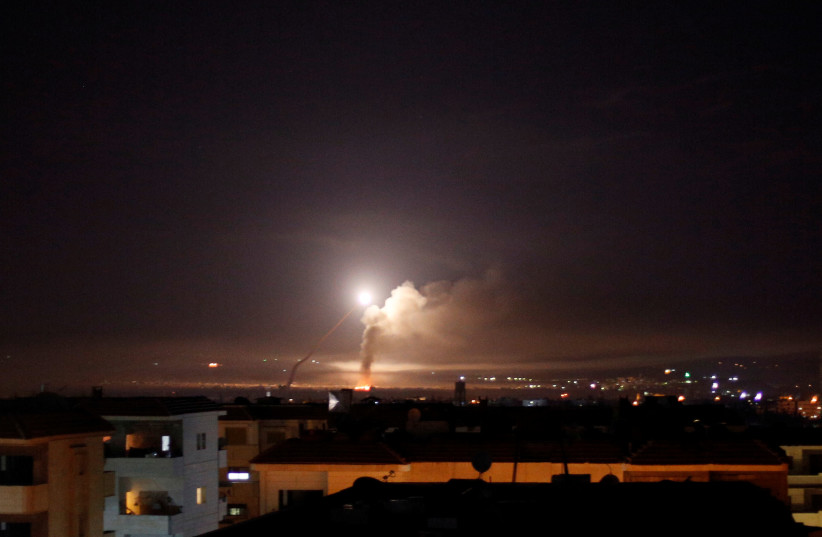 Missile fire is seen from Damascus, Syria May 10, 2018 (photo credit: REUTERS/OMAR SANADIKI)