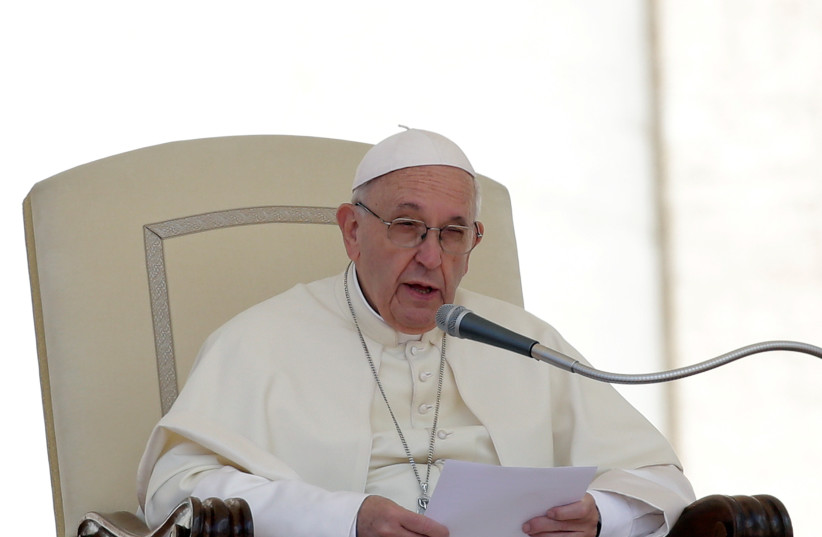 Pope Francis speaks during the Wednesday general audience in Saint Peter's square at the Vatican, May 16, 2018. (photo credit: REUTERS/MAX ROSSI)