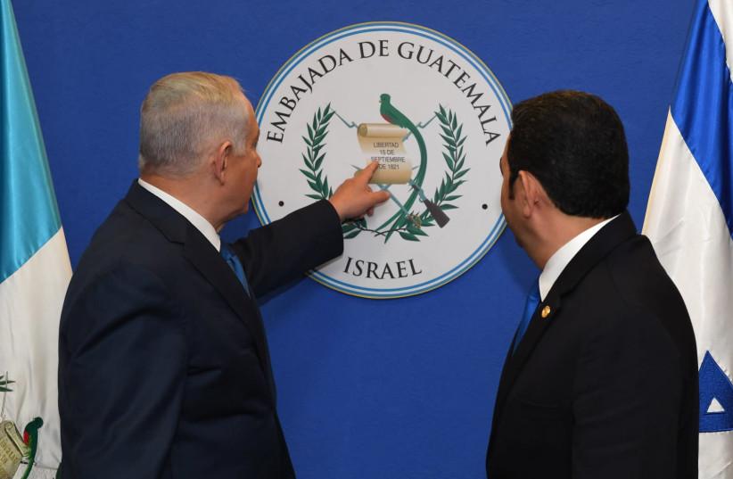 Prime Minister Benjamin Netanyahu with Guatemalan President Jimmy Morales at the opening of the Guatamalan embassy in Jerusalem (photo credit: KOBI GIDEON/GPO)
