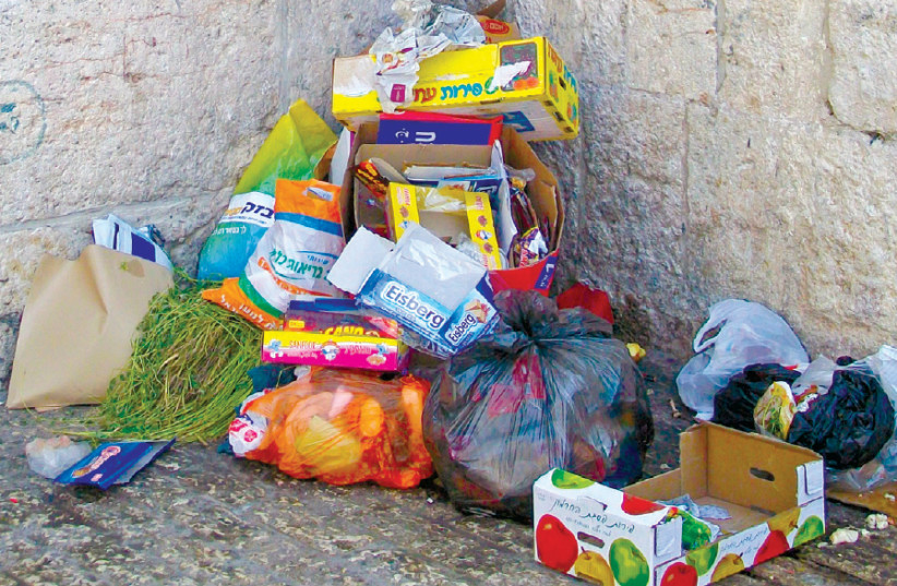 Garbage dumped in the Old City (photo credit: Wikimedia Commons)