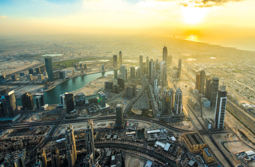 The view of downtown Dubai at sunset from the Burj Khalifa, the world's tallest building (photo credit: Wikimedia Commons)