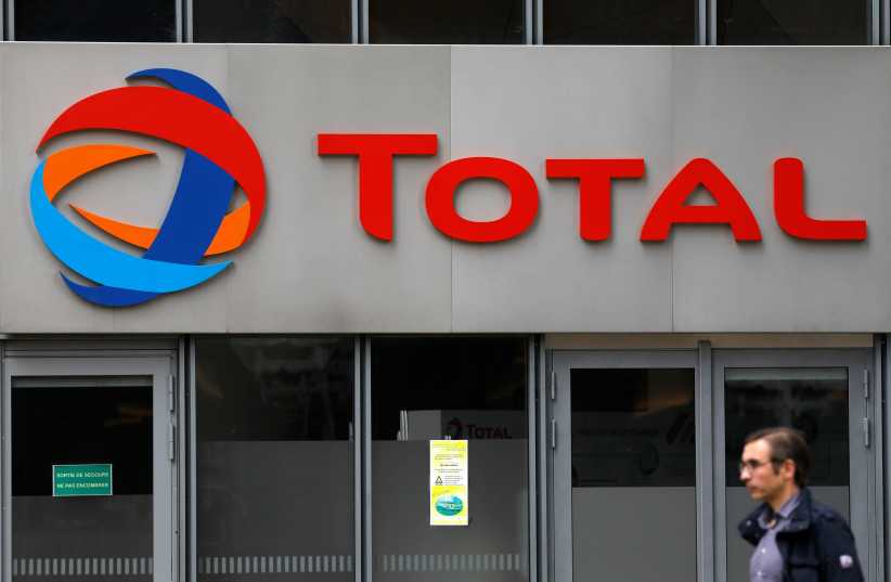 The logo of French oil giant Total is seen at La Defense business and financial district in Courbevoie, near Paris, France. May 16, 2018 (photo credit: REUTERS)