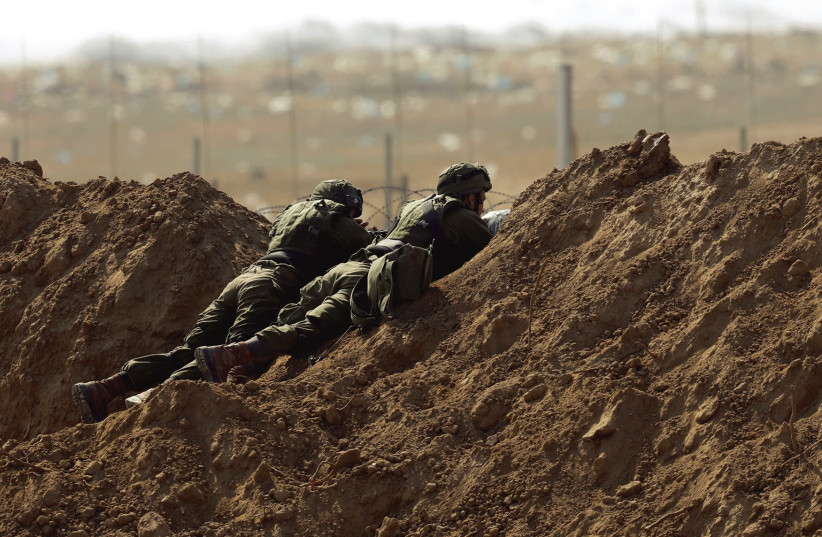 IDF soldiers stationed near the Gaza border on May 15th, 2018. (photo credit: AMIR COHEN/REUTERS)