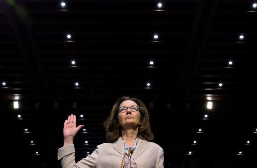 CIA director nominee and acting CIA Director Gina Haspel is sworn in to testify at her Senate Intelligence Committee confirmation hearing on Capitol Hill in Washington, US, May 9, 2018. (photo credit: AARON P. BERNSTEIN/ REUTERS)