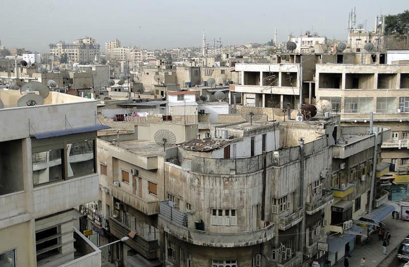 Hama, Syria [file photo] (photo credit: BERNARD GAGNON- WIKIMEDIA)