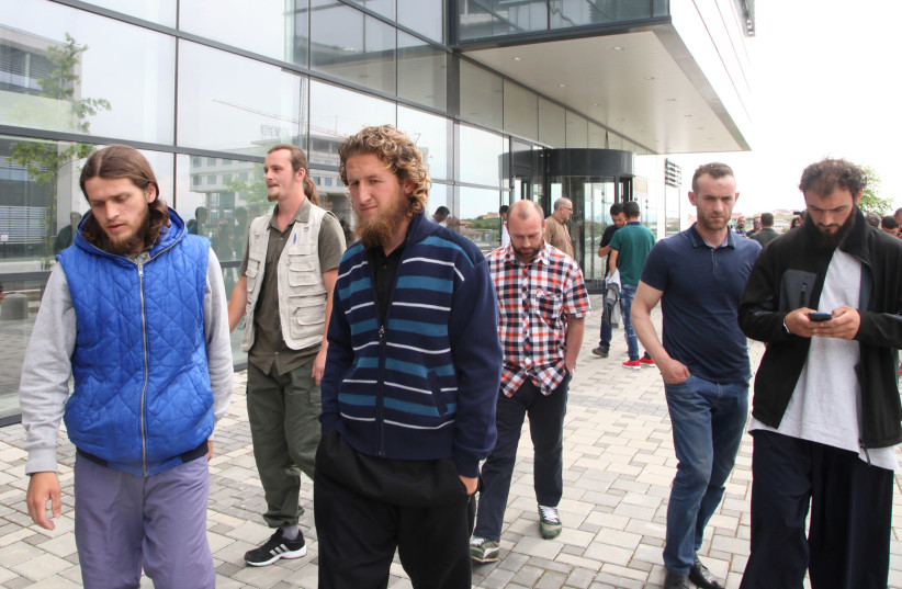 Several of the Kosovar men convicted of plotting to attack the Israeli national soccer team walk in front of a court after their sentencing (photo credit: HAZIR REKA/ REUTERS)