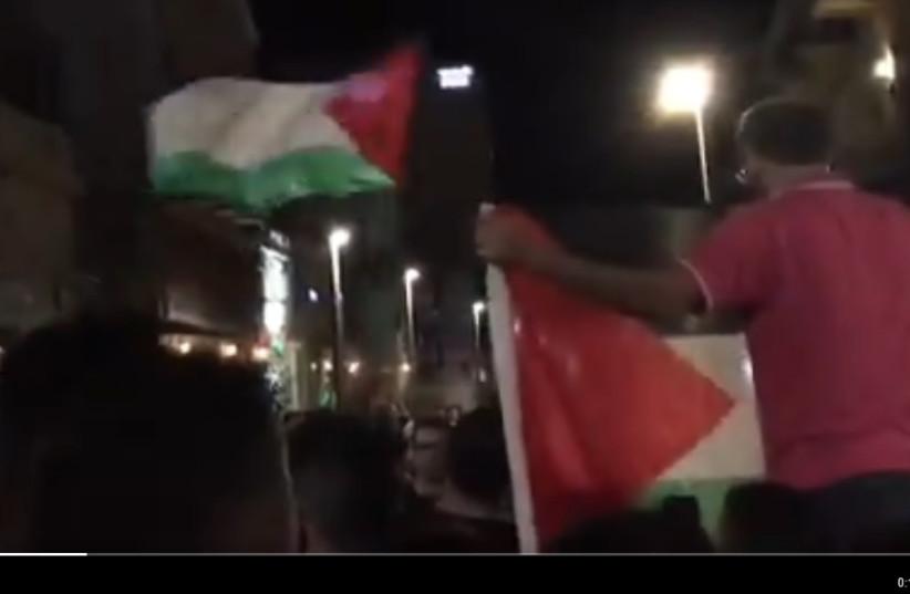 Protesters holding Palestinian flags in Haifa, Israel.  (photo credit: SOCIAL MEDIA)