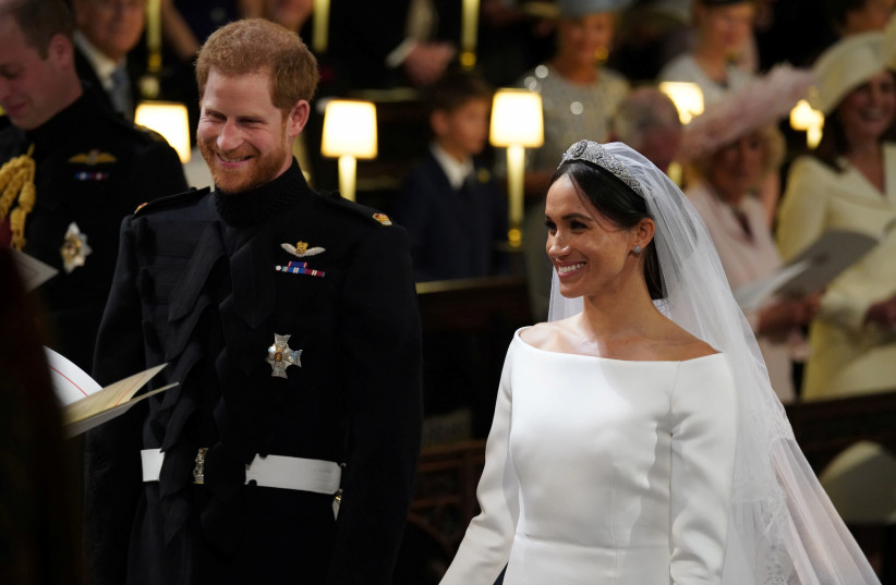 His Royal Highness Prince Harry, Duke of Sussex and Her Royal Highness Meghan Markle, Duchess of Sussex, at their wedding (photo credit: POOL)