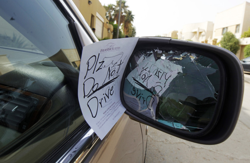 A note placed by an unknown person on female driver Azza Al Shmasani's car, is pictured in Saudi Arabia June 22, 2011. Saudi Arabia has no formal ban on women driving. But as citizens must use only Saudi-issued licences in the country, and as these are issued only to men, women drivers are anathema. (photo credit: FAHAD SHADEED/ REUTERS/ FILE PHOTO)