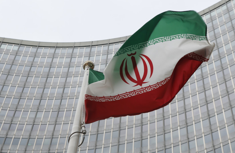 An Iranian flag flutters in front of the International Atomic Energy Agency (IAEA) headquarters in Vienna, Austria, January 15, 2016 (photo credit: REUTERS)