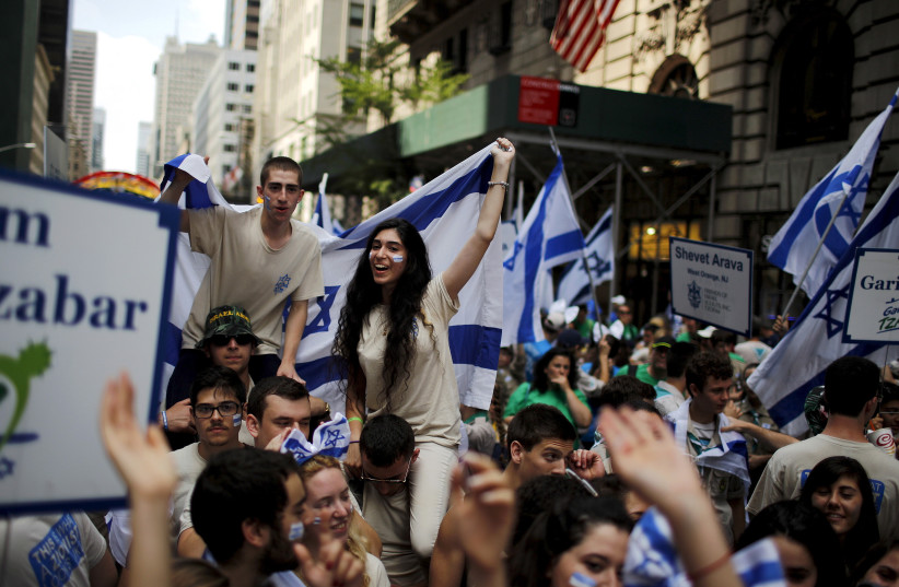 People take part in the 51st annual Israel parade in Manhattan, New York May 31, 2015. (photo credit: REUTERS/EDUARDO MUNOZ)