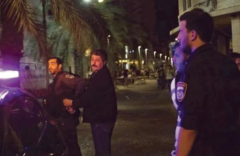 Police arrest Jafar Farah, director of the Mossawa Center, in Haifa on Friday night. (photo credit: MOSSAWA CENTER)