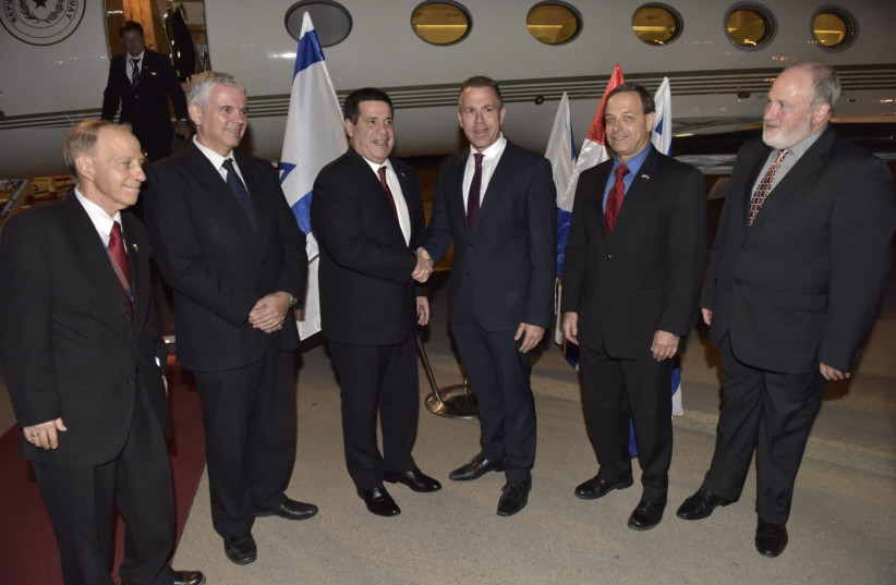 Public Security Minister Gilad Erdan greets Paraguayan President Horacio Cartes Sunday night upon his arrival to Israel. (photo credit: COURTESY FOREIGN MINISTRY)