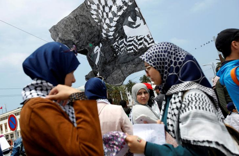 Pro-Palestinian protesters participate in a protest organized by Al Adl wal Ihsane, a Moroccan Islamist association, in solidarity with the Palestinian people, in Casablanca, Morocco May 20, 2018. (photo credit: YOUSSEF BOUDLAL / REUTERS)