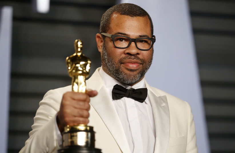 Director Jordan Peele at the 2018 Vanity Fair Oscar Party (photo credit: DANNY MOLOSHOK/REUTERS)