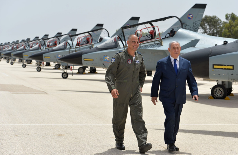 Prime Minister Benjamin Netanyahu and IAF Brigadier General Peleg Niego at Tel Nof Airbase in Rehovot, May 23, 2018 (photo credit: PMO)