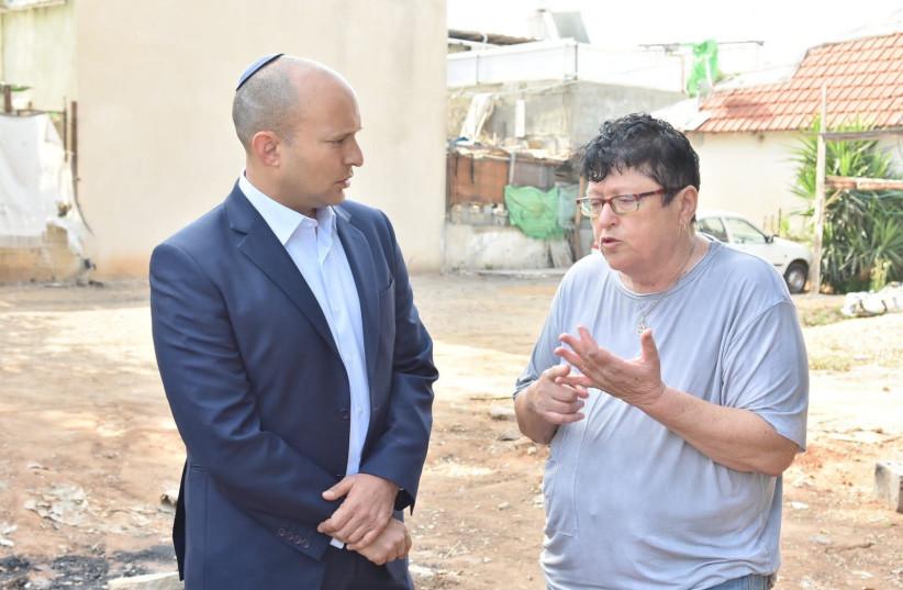 Naftali Bennett (L) with anti-migrant activist Sheffi Paz (R) (photo credit: MICHAEL DIMENSTEIN)