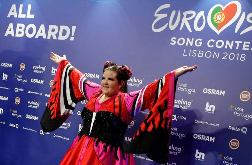 Israel's Netta arrives for the news conference after winning the Grand Final of Eurovision Song Contest 2018 at the Altice Arena hall in Lisbon, Portugal, May 13, 2018. (photo credit: REUTERS/PEDRO NUNES)