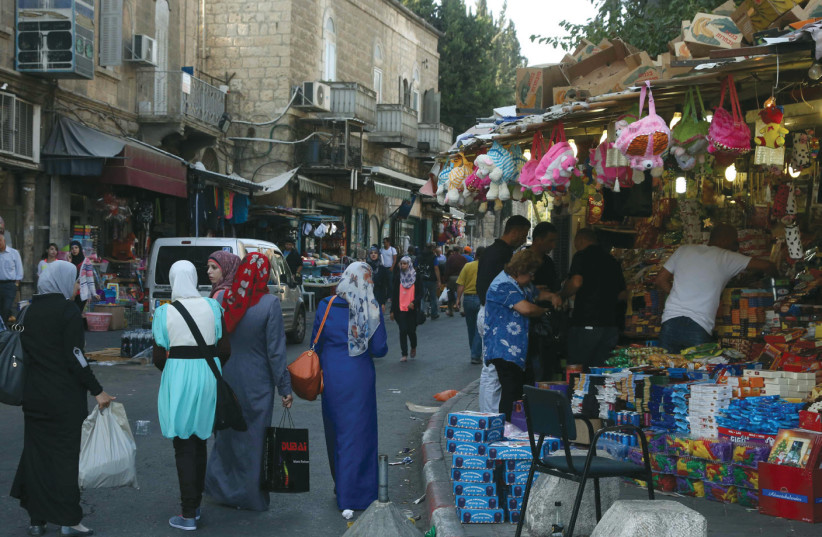 JERUSALEM RESIDENTS walk near Damascus Gate. (photo credit: MARC ISRAEL SELLEM/THE JERUSALEM POST)
