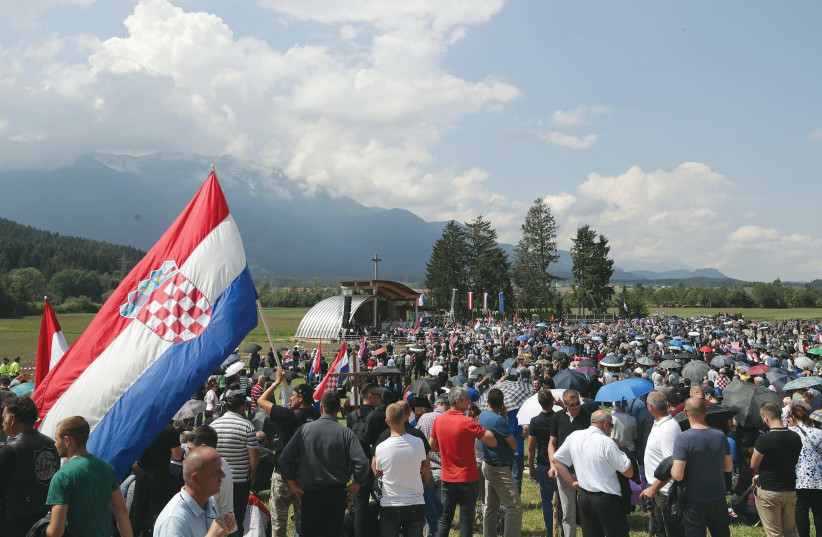 PARTICIPANTS TAKE part in a Catholic ceremony commemorating the turning away from Austria of pro-Nazi Croatians at the end of the Second World War. (photo credit: REUTERS)