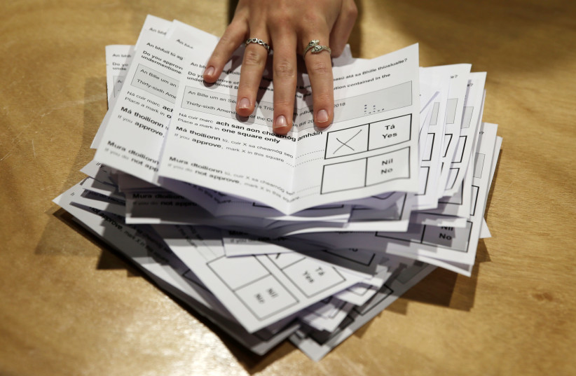 Votes are tallied folowing yesterday's referendum on liberalizing abortion law, in Dublin, Ireland, May 26, 2018 (photo credit: REUTERS/MAX ROSSI)