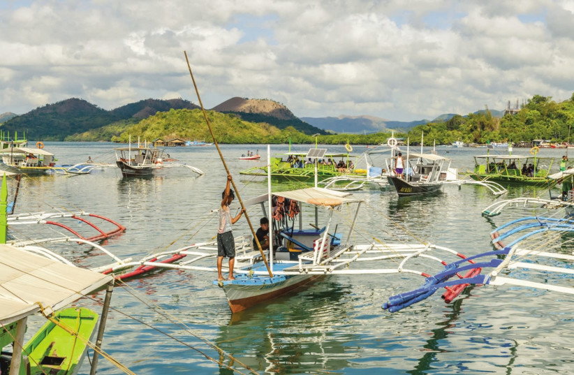 Boats at Coron harbor are for hire to get to various sites on Coron Island, May 27, 2018. (photo credit: HILLARY ZETLER)