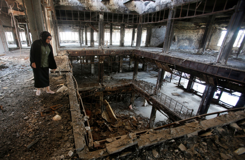 Raghad Hammoudi, who is a member of a group of students campaigning to help rebuild the Central Library of Mosul University, is seen in Mosul, Iraq May 14, 2018 (photo credit: KHALID AL MOUSILY / REUTERS)