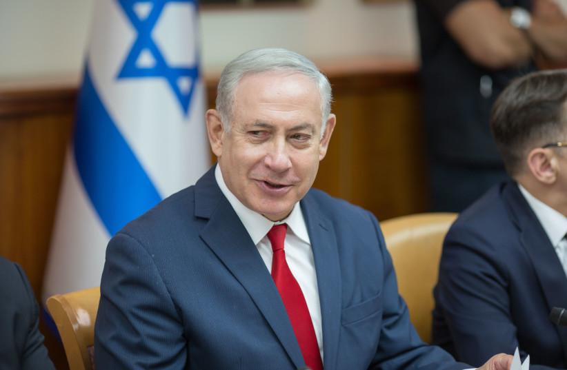 Prime Minister Benjamin Netanyahu at a weekly cabinet meeting, May 27, 2018. (photo credit: EMIL SALMAN/POOL)
