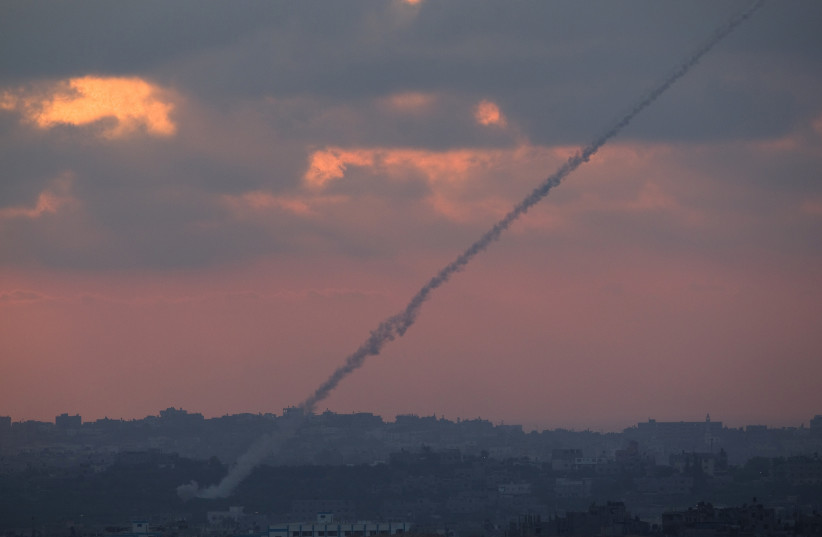 Smoke trails are seen as rockets are launched from the Gaza Strip towards Israel as seen from the Israeli border August 23, 2014 (photo credit: REUTERS/AMIR COHEN)
