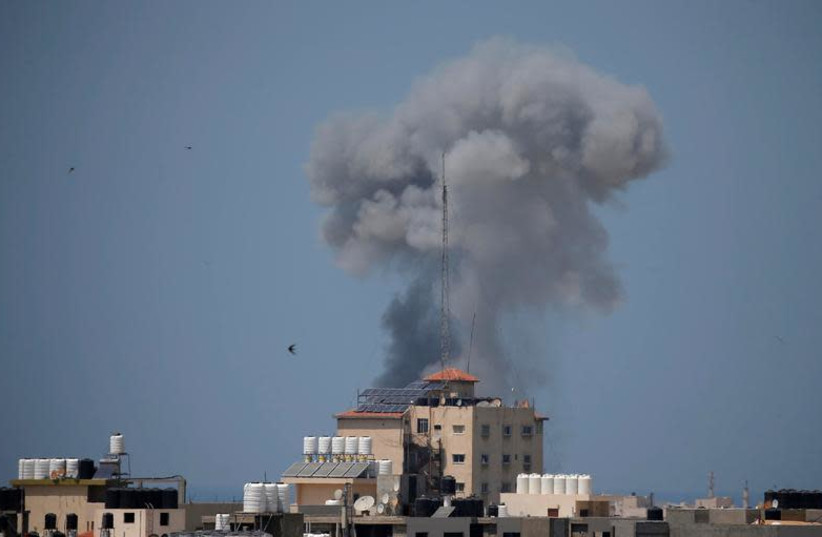 Smoke rises following an Israeli air strike in Gaza May 29, 2018. (photo credit: SUHAIB SALEM / REUTERS)