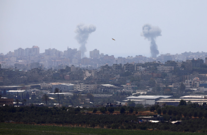 Smoke rises following an Israeli air strike in the Gaza Strip, as seen from the Israeli side of the border between Israel and Gaza, May 29, 2018 (photo credit: AMIR COHEN/REUTERS)