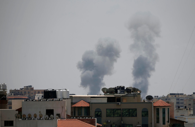 Smoke rises following an Israeli air strike in Gaza May 29, 2018 (photo credit: SUHAIB SALEM / REUTERS)