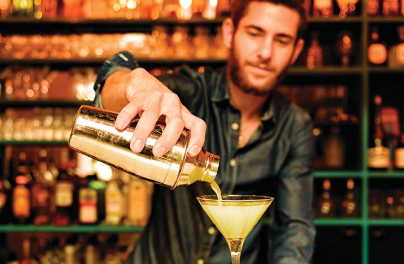 Gil Barnea pours a martini (photo credit: NIR ROITMAN/TAP & TAIL)