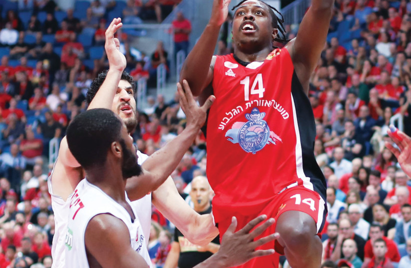 Hapoel Gilboa/Galil guard J'Covan Brown drives to the basket during last night's 85-78 road win over Hapoel Jerusalem in Game 1 of their BSL quarterfinal series (photo credit: DANNY MARON)