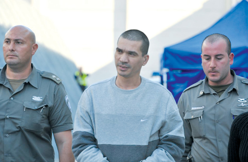 Israeli mob boss Itzhak Abergil appears at an extradition hearing. (photo credit: ISRAEL POLICE)