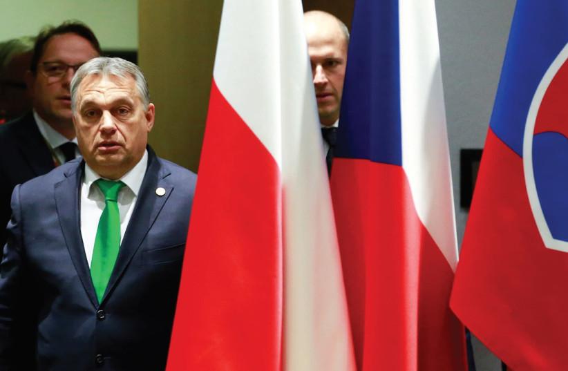 HUNGARY'S PRIME Minister Viktor Orban arrives for a Visegrad Group meeting in Brussels last December. (photo credit: REUTERS)