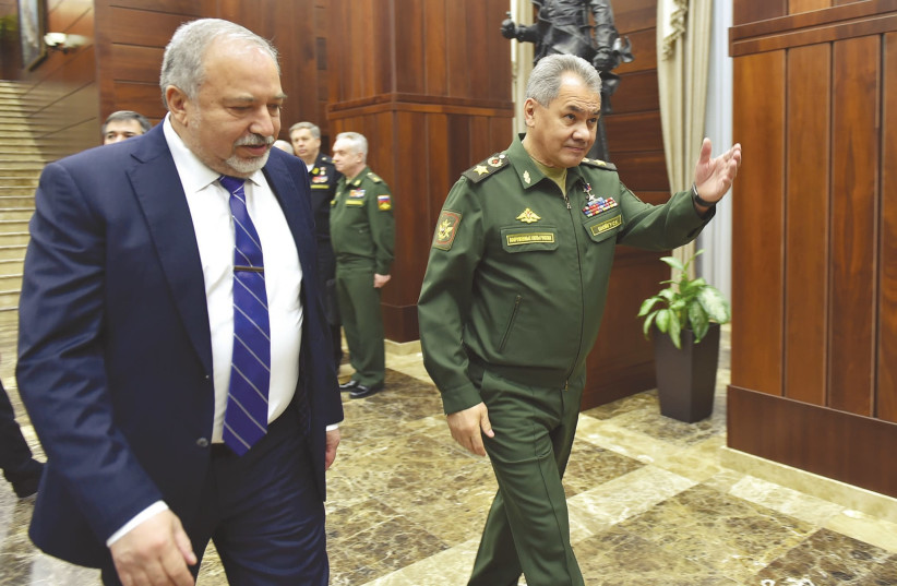 DEFENSE MINISTER Avigdor Liberman and his Russian counterpart, Sergei Shoigu, walk to their meeting in Moscow, May 31, 2018. (photo credit: ARIEL HERMONI / DEFENSE MINISTRY)